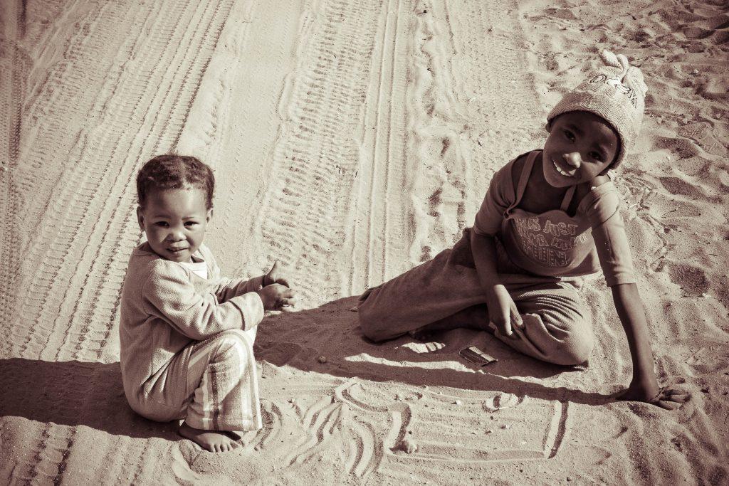 Children sitting on floor, photo by KB Mpofu