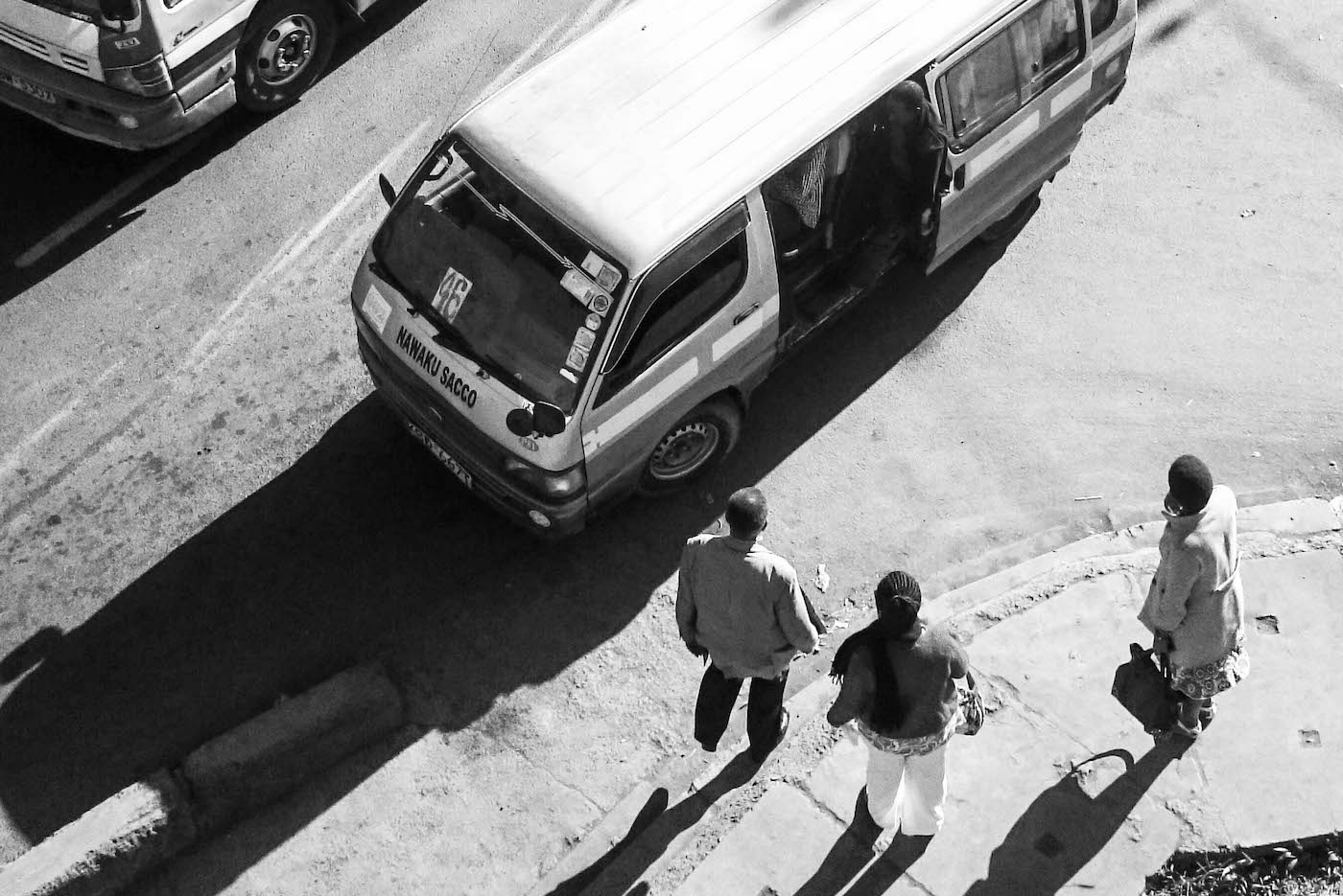 Men waiting for mini bus, photo by Mwangi Kirubi