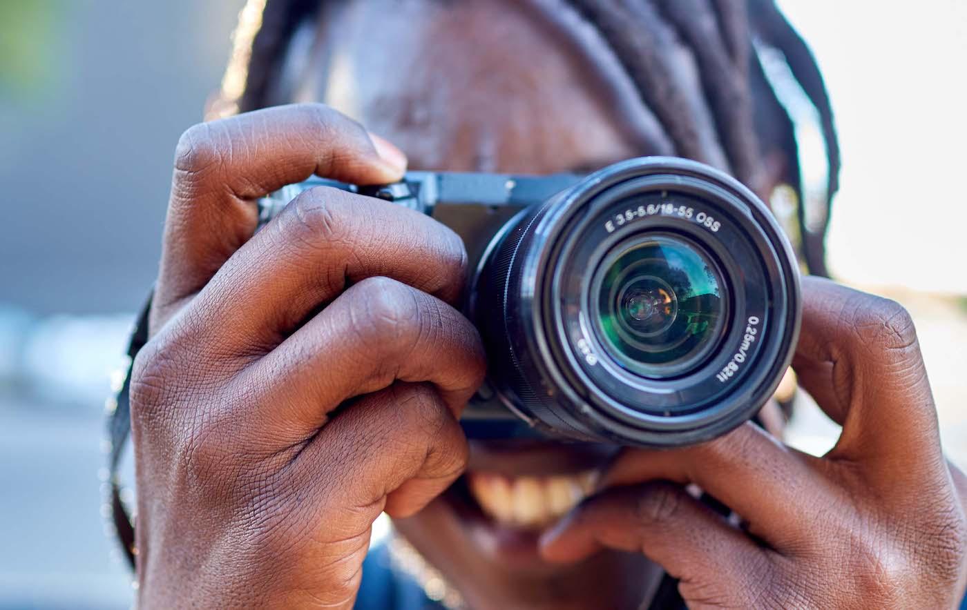 Young man using camera, Kudakwashe Mushauri