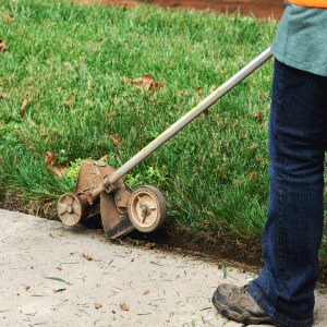 Lawn mowing service includes edging of the lawn using an edger or weed whacker.