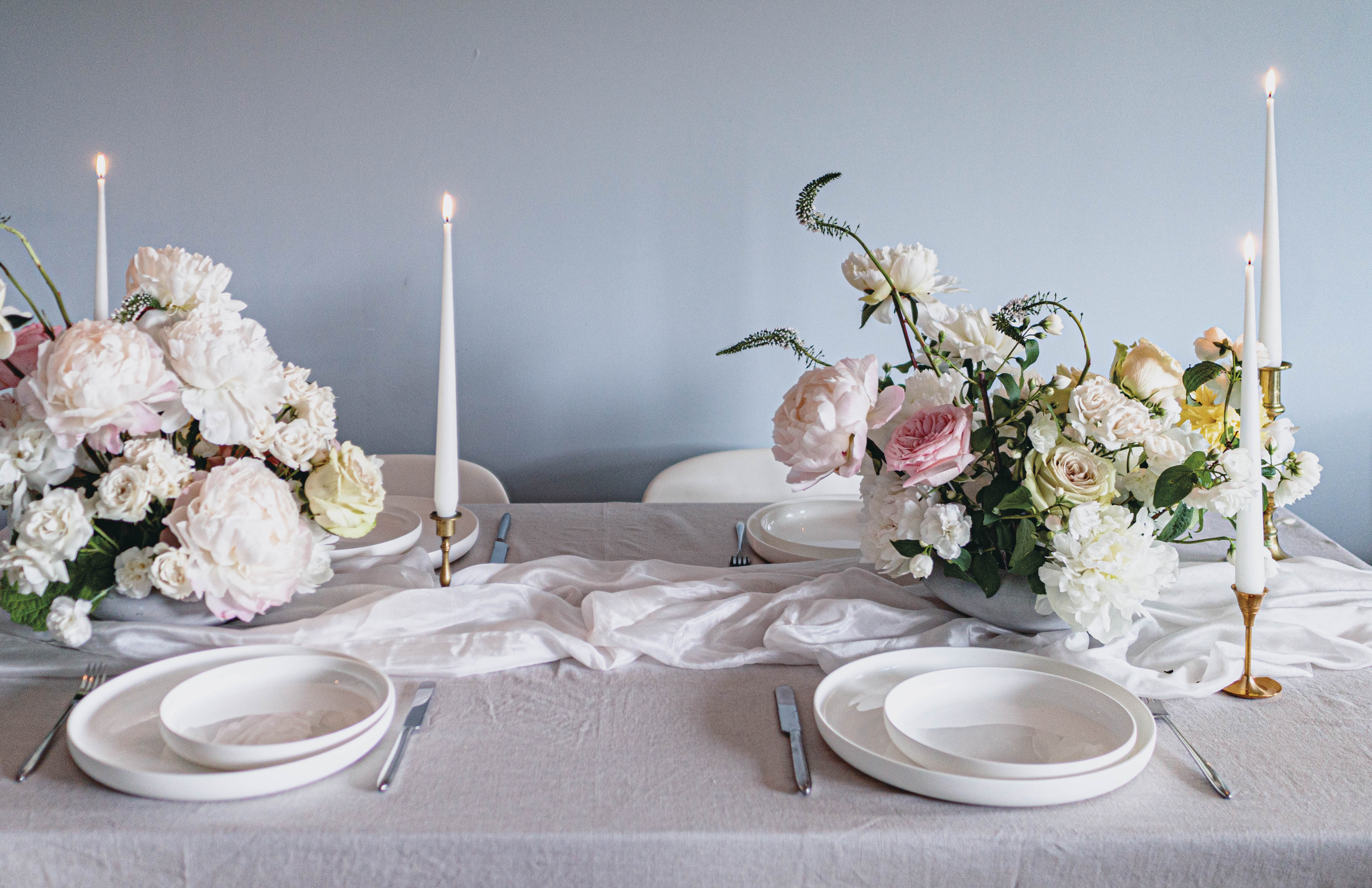 Peonies and Roses Wedding Table Centrepieces and Table Set-up with White Round Plates and Tapered Candles in Antique French Candlestick