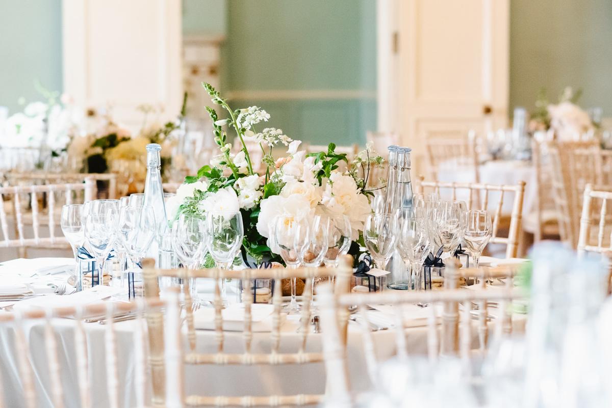 Spring Flower arrangements in wedding breakfast room in Dartmouth House