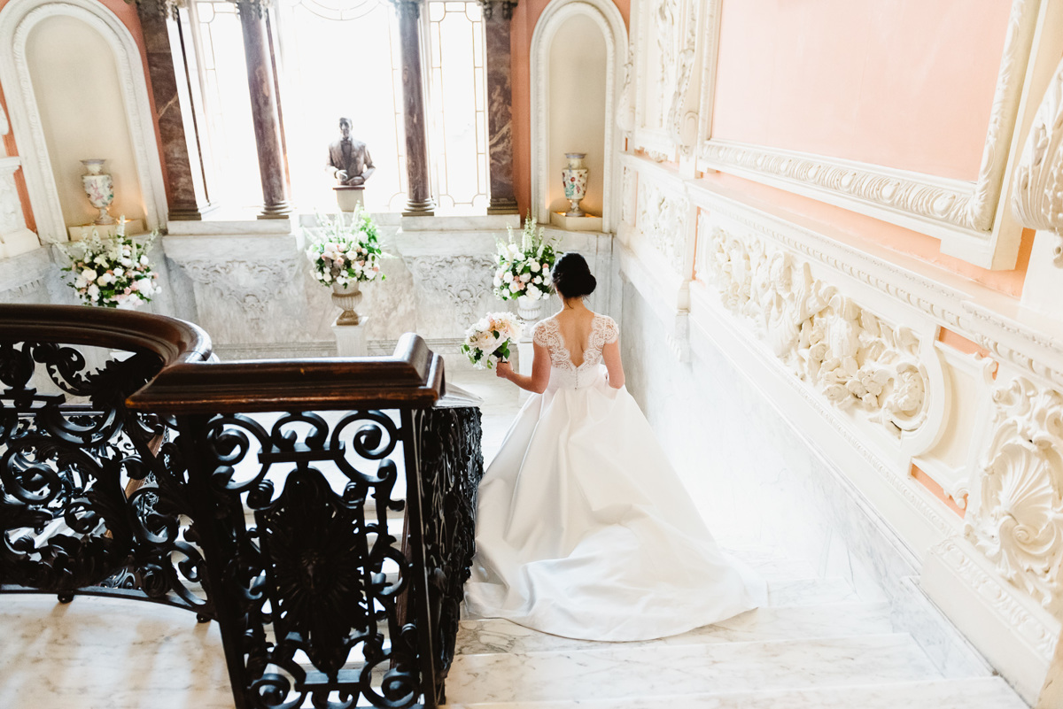 Bride walking down the staircase in Dartmouth House
