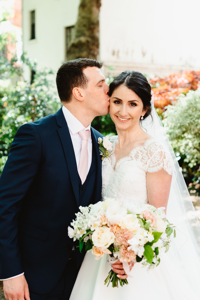 Bride with her wedding bouquet and Groom
