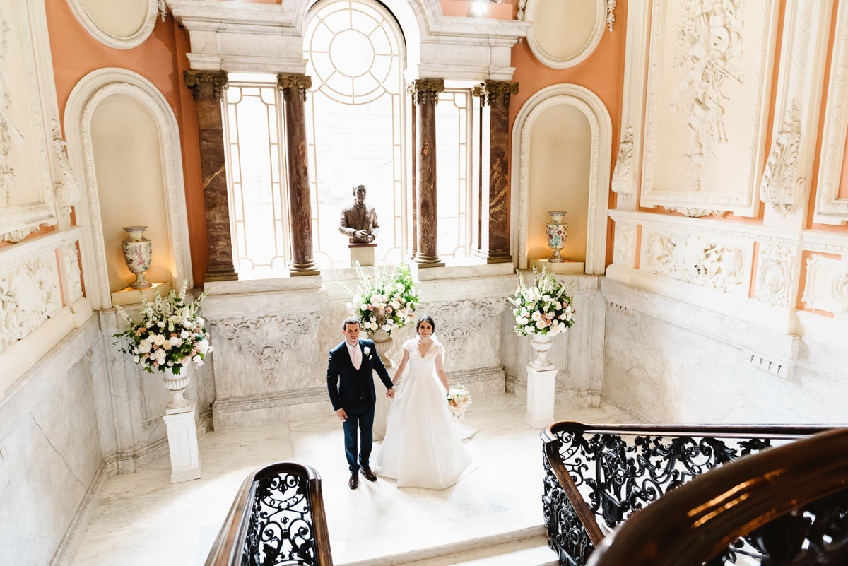 Bride and Groom on staircase in Dartmouth house