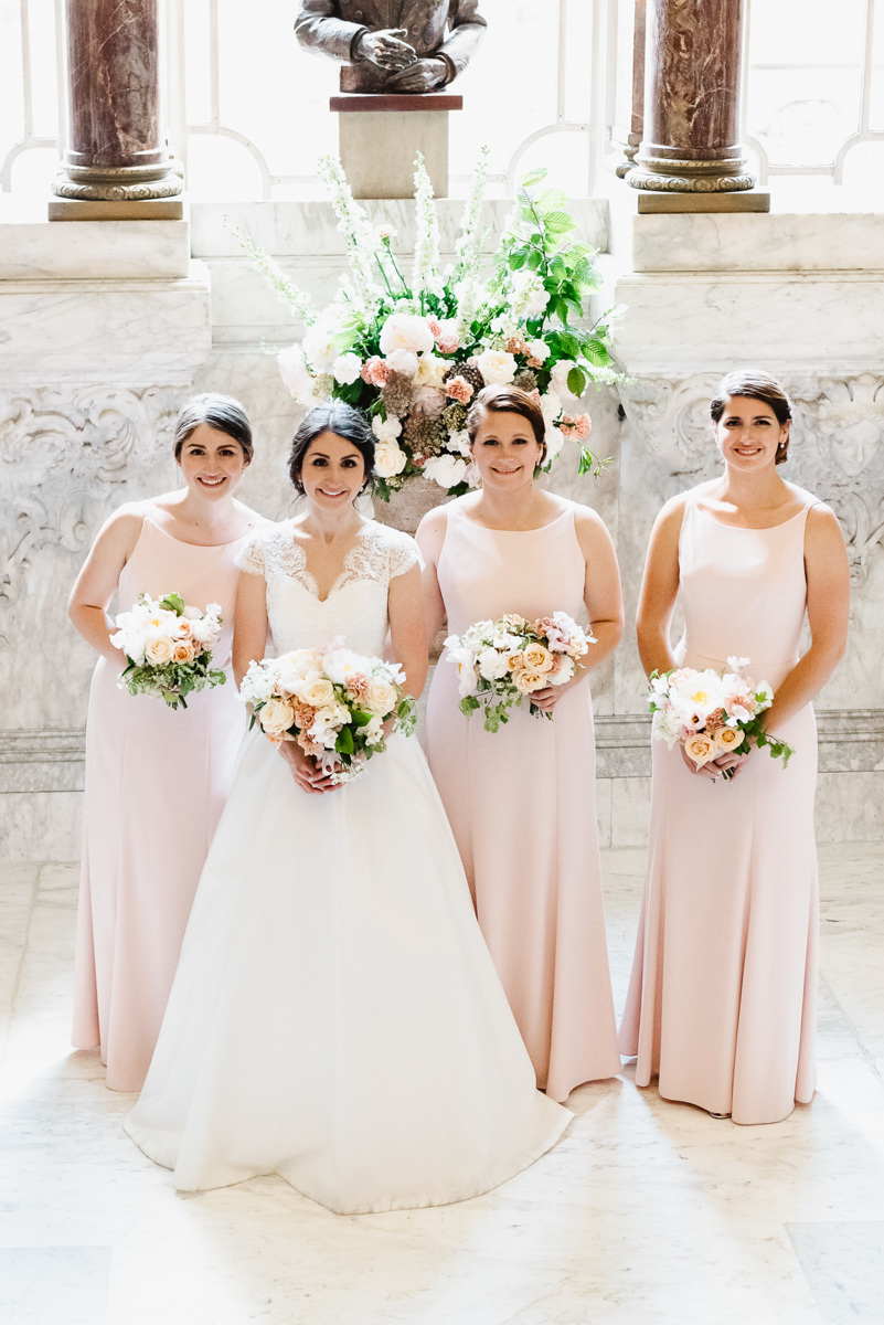 Bride and bridesmaids with wedding flowers in Dartmouth House