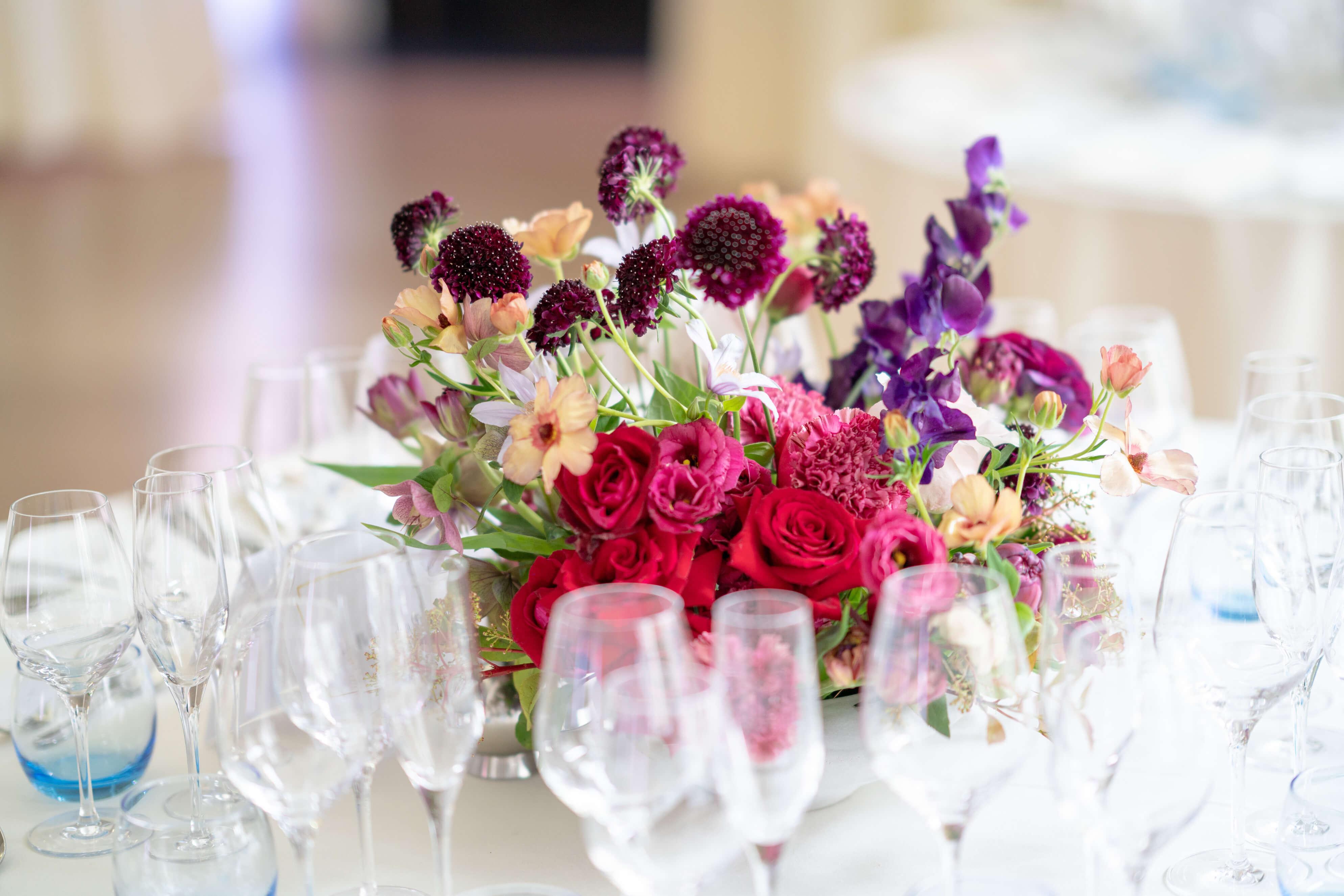 Roses and scabiosas wedding flower arrangements