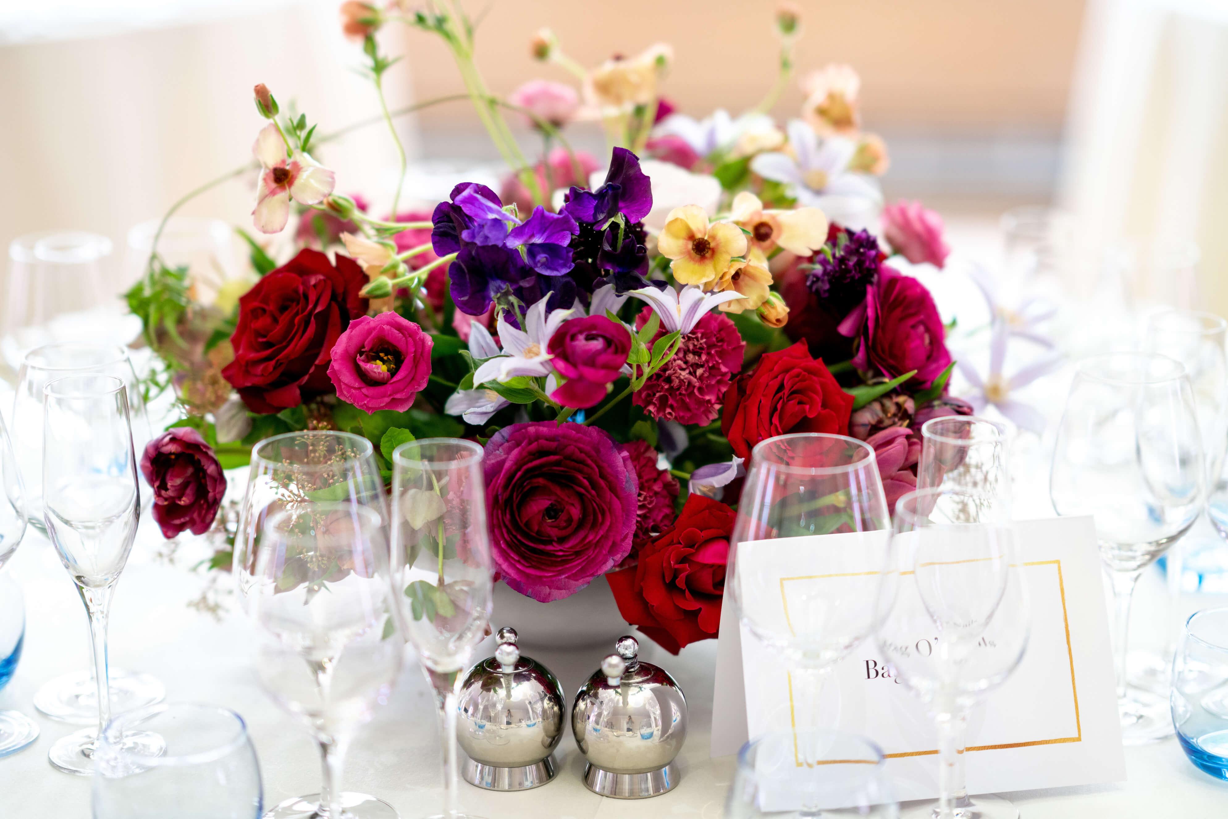 Close up of flower arrangements at central London wedding venue