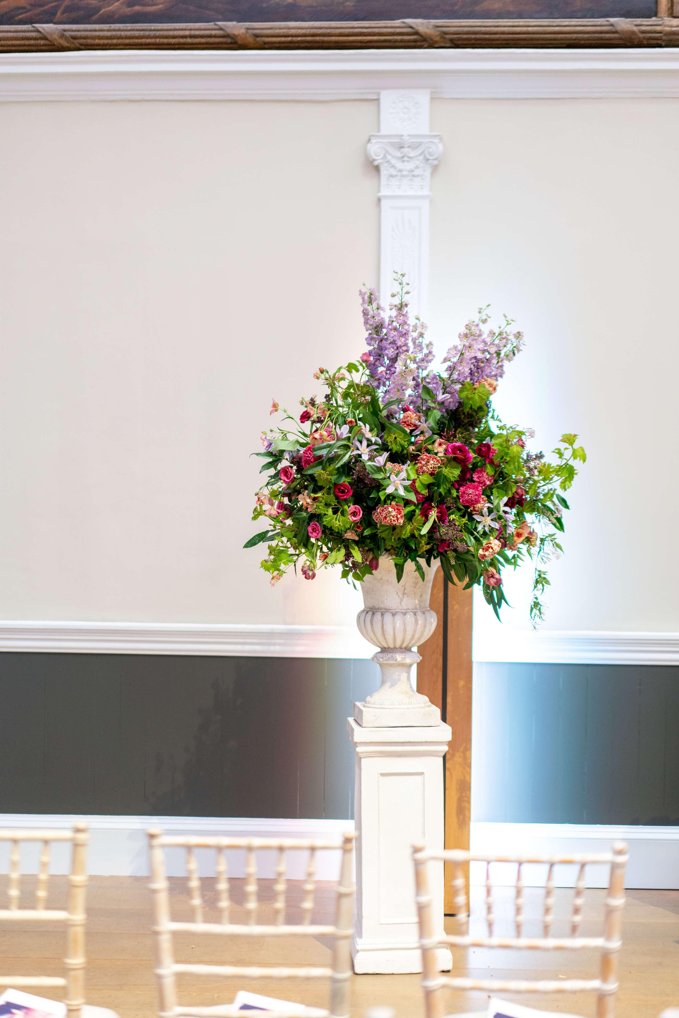 Tall ceremony aisle flower centrepiece arrangement