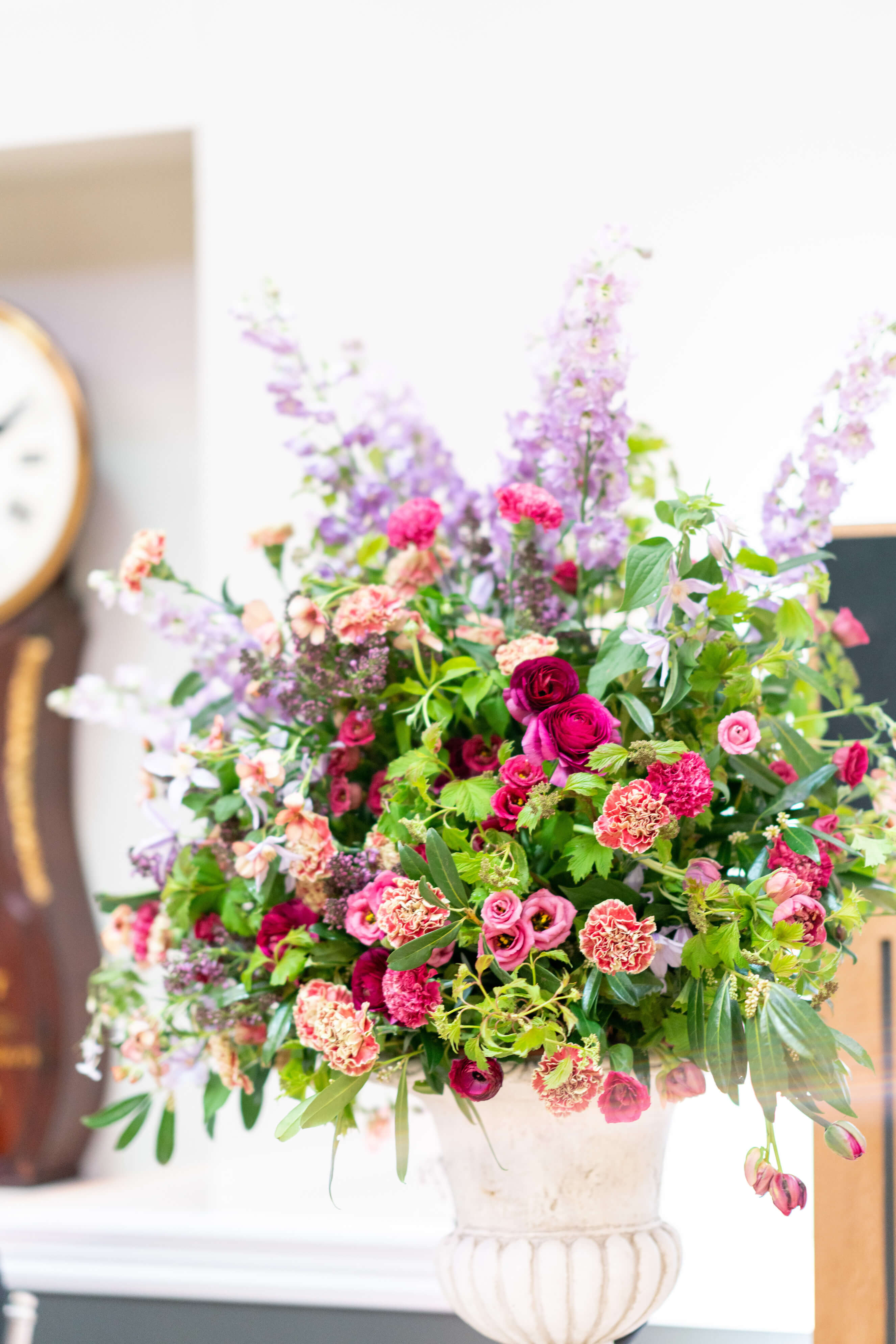 Tall ceremony aisle flower arrangement