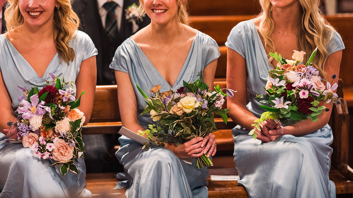 London bridesmaids in pastel blue dresses with romantic and wild Bouquets