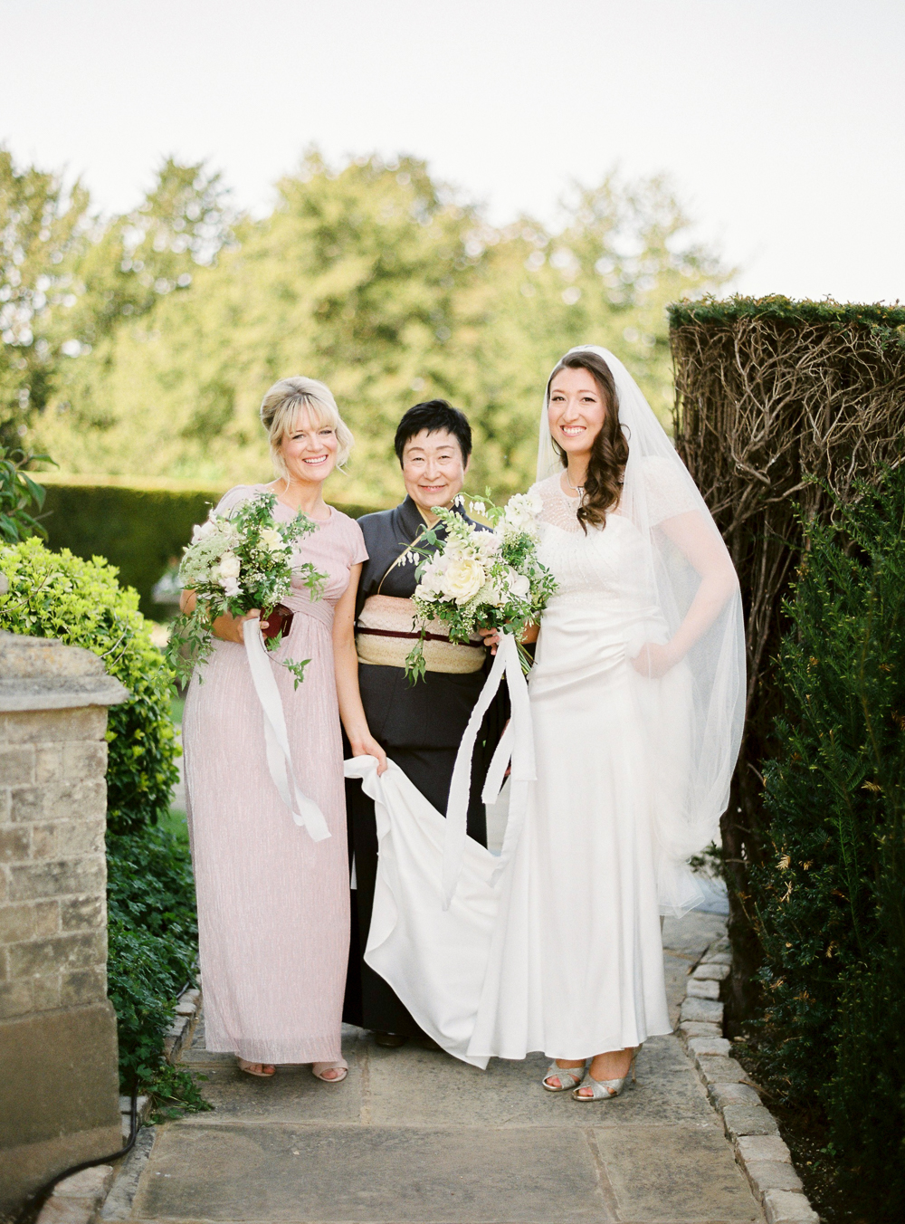 Bride and Bridesmaid with Wedding Bouquets