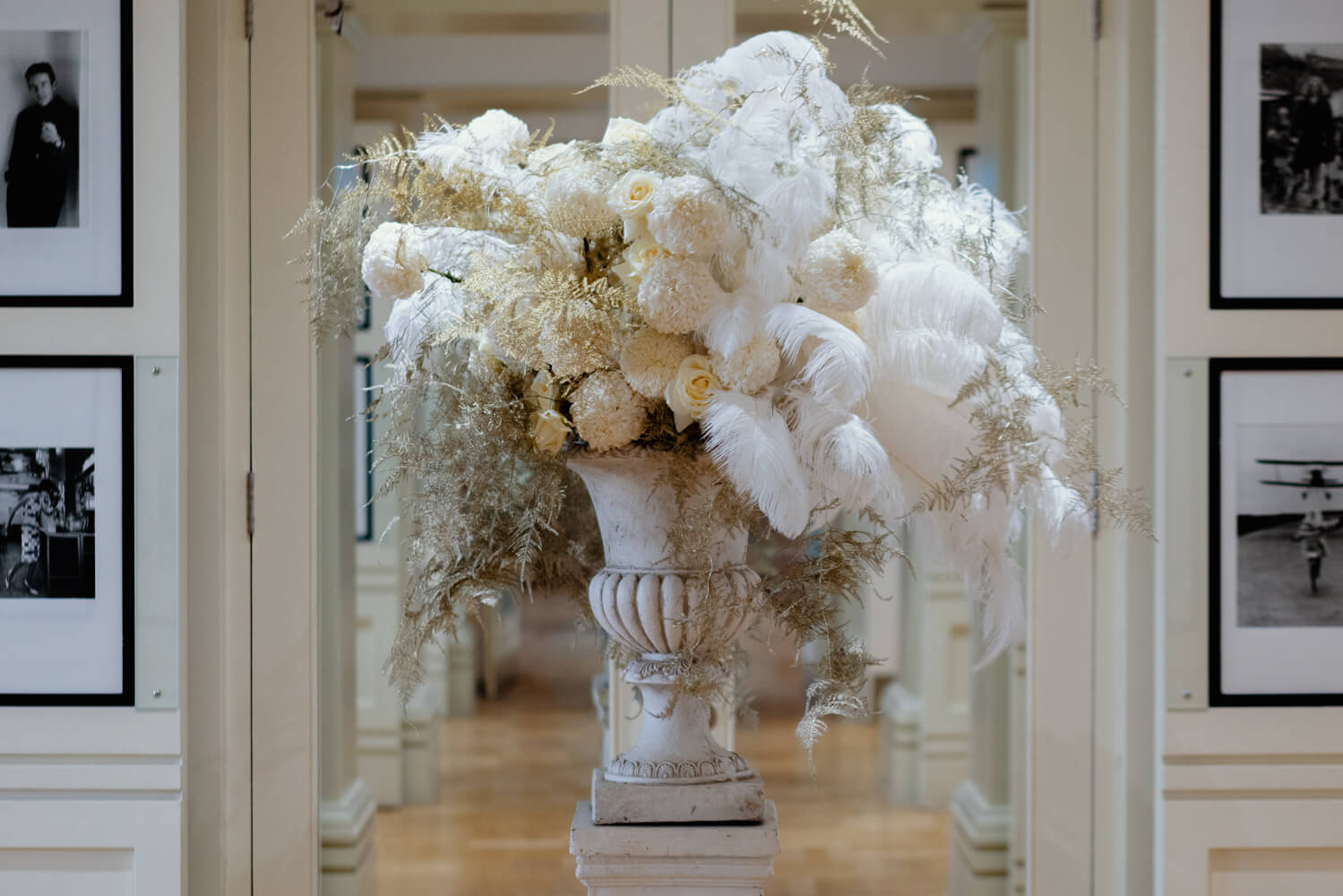Large wedding arrangement with feathers
