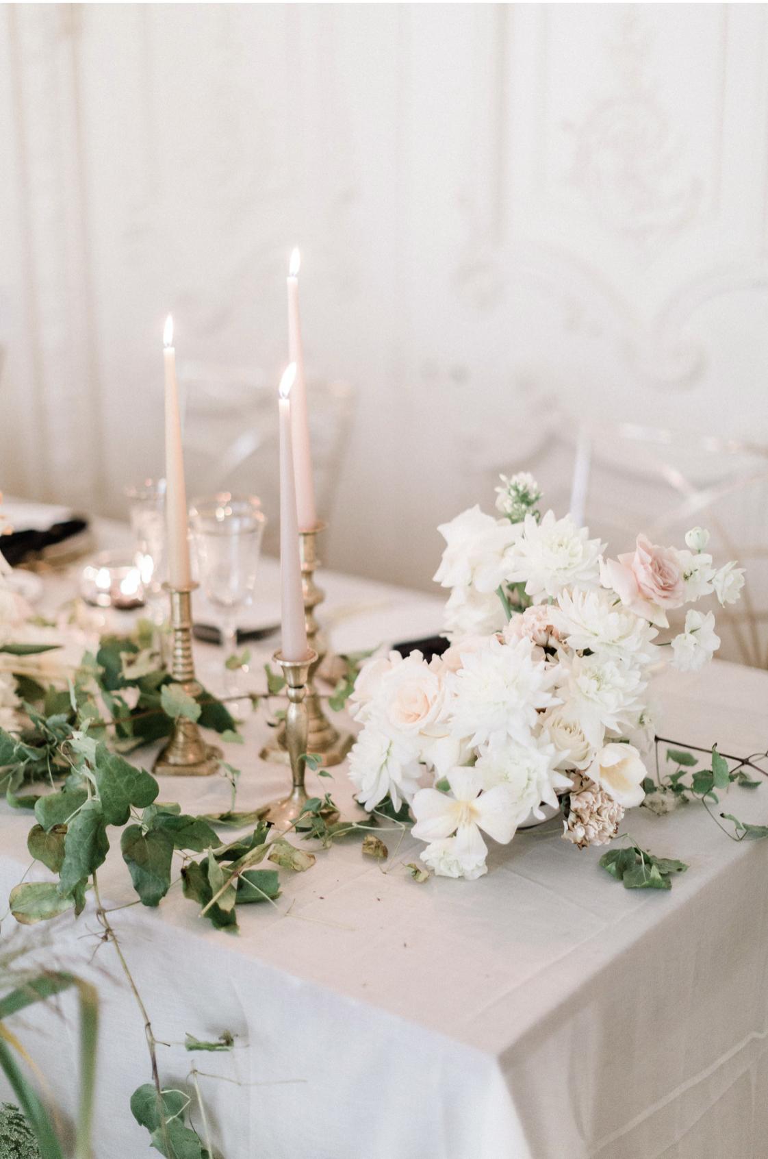 Romantic white wedding centrepiece