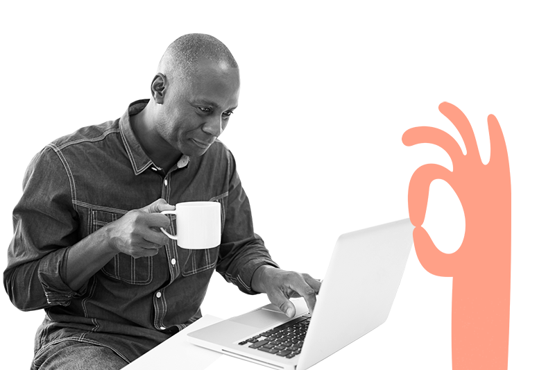 Man reading his laptop with a coffee.