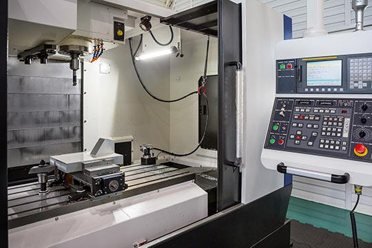 What parts make up the CNC machine