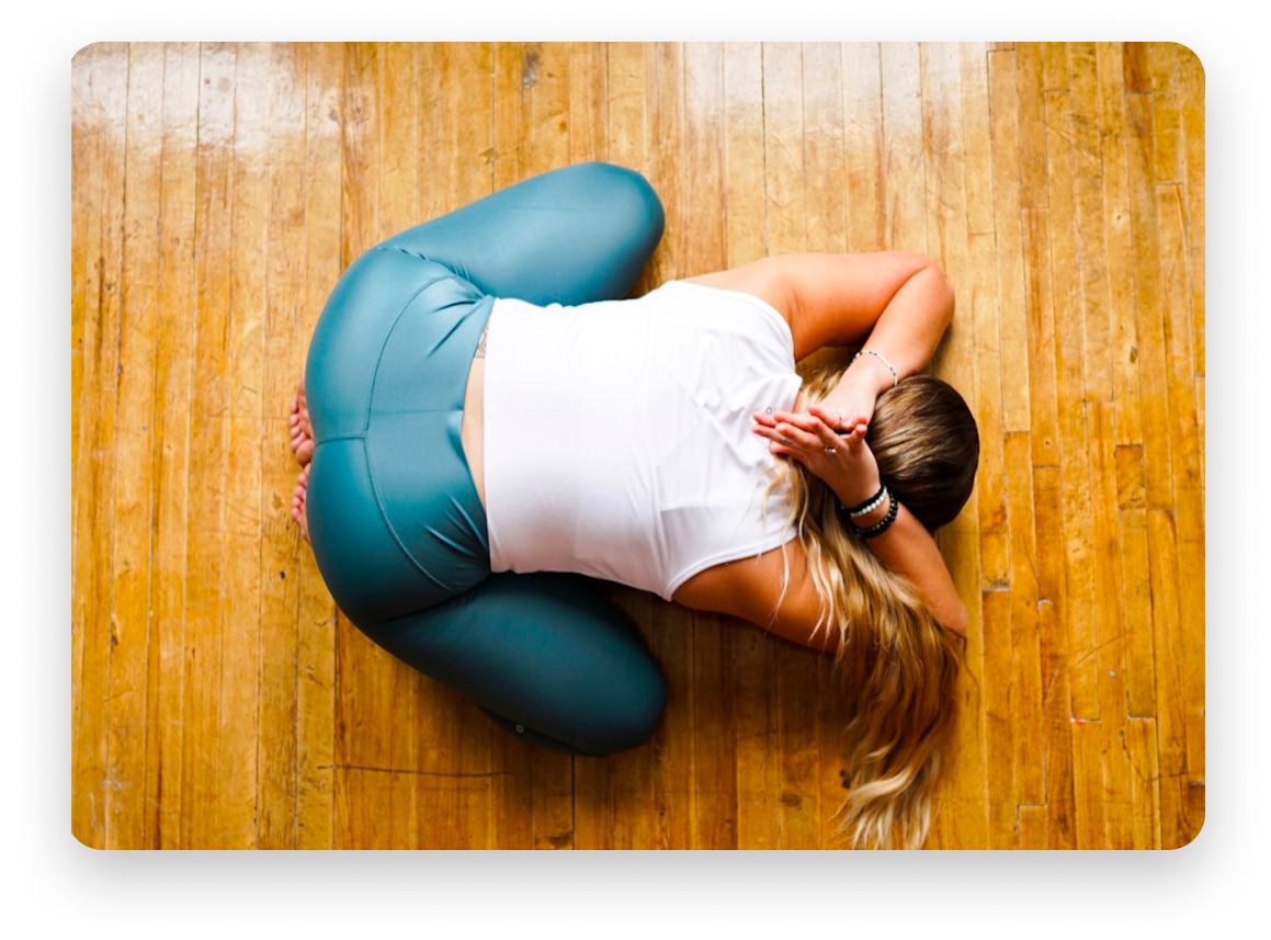 Woman in the middle of a yoga pose