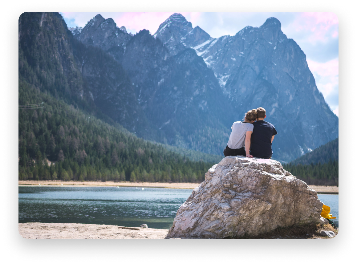 Couple looking up at mountains