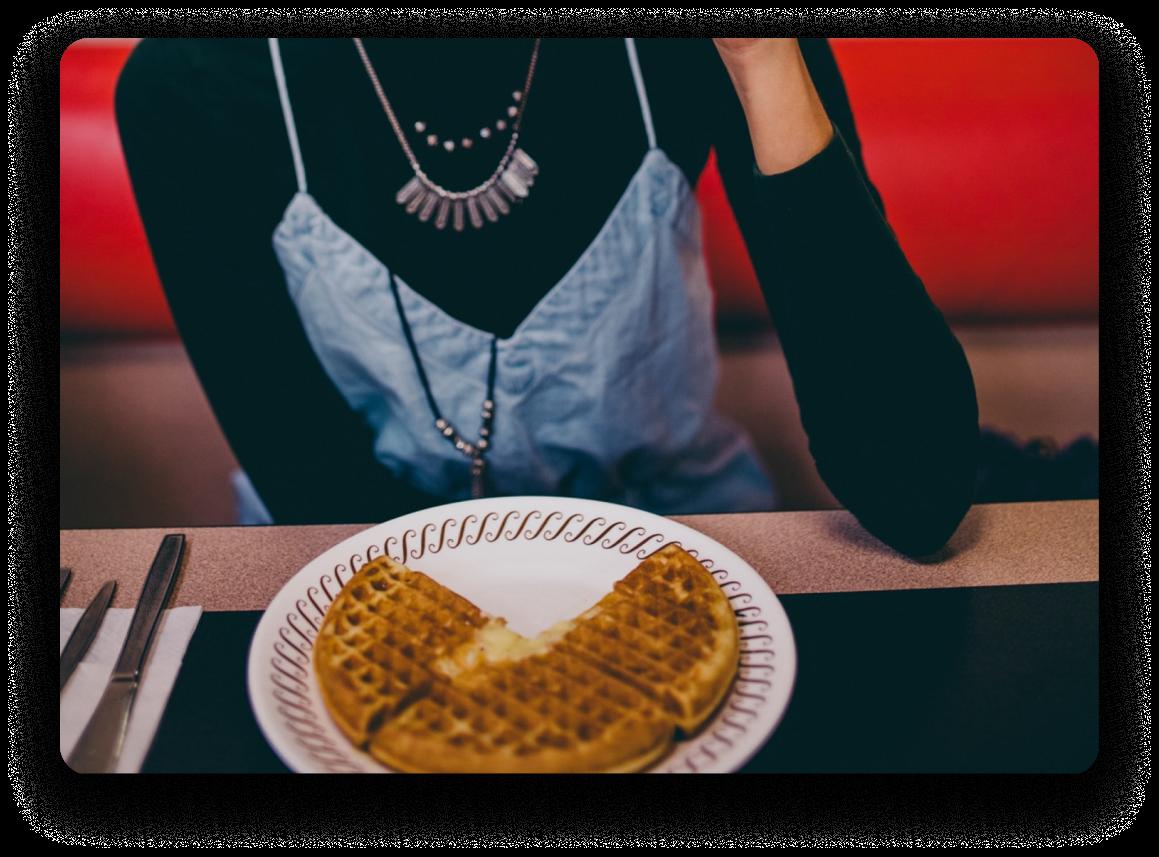 Woman eating waffles