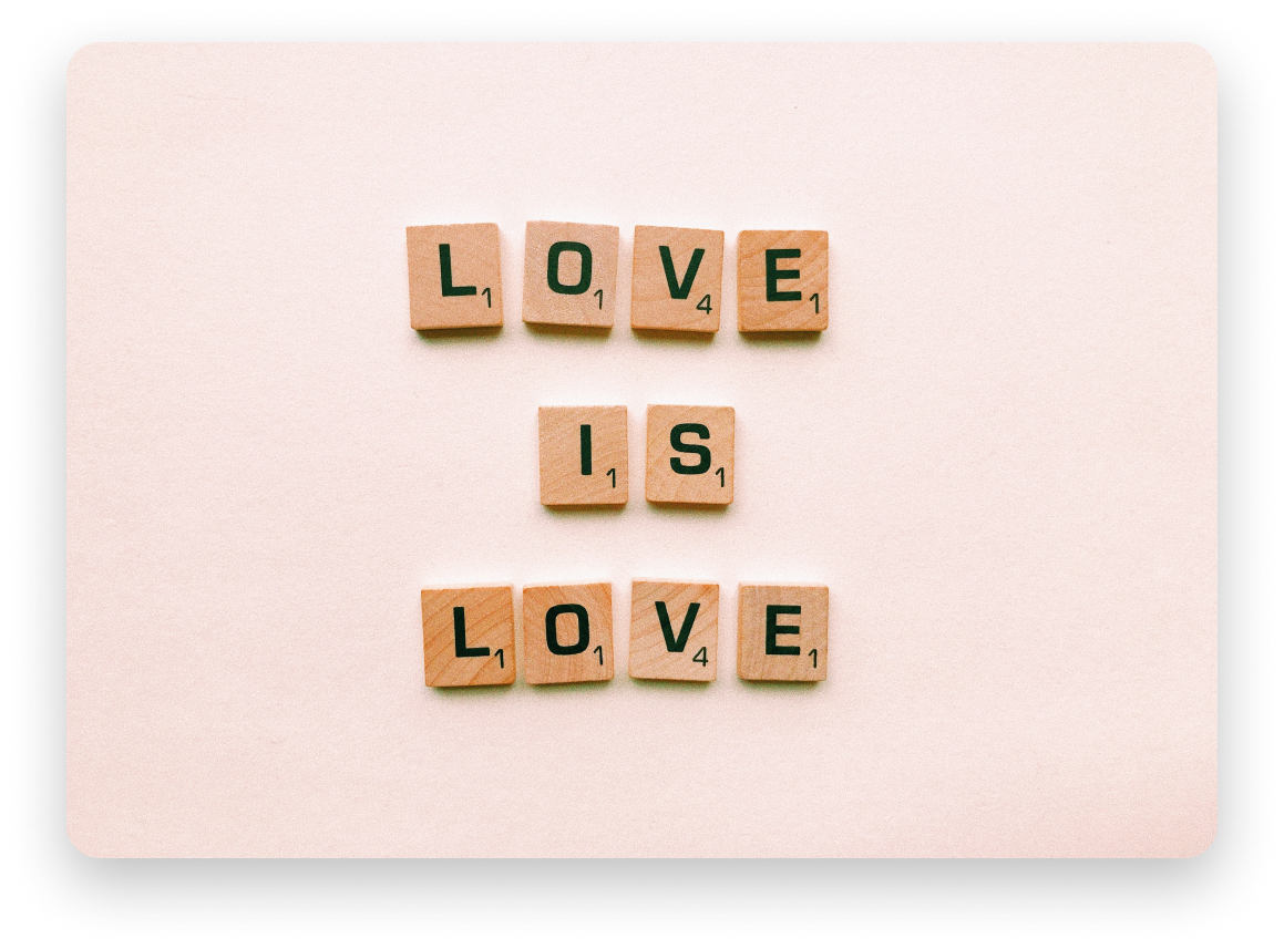"""Scrabble letters laid out to spell """"Love is love"""""""