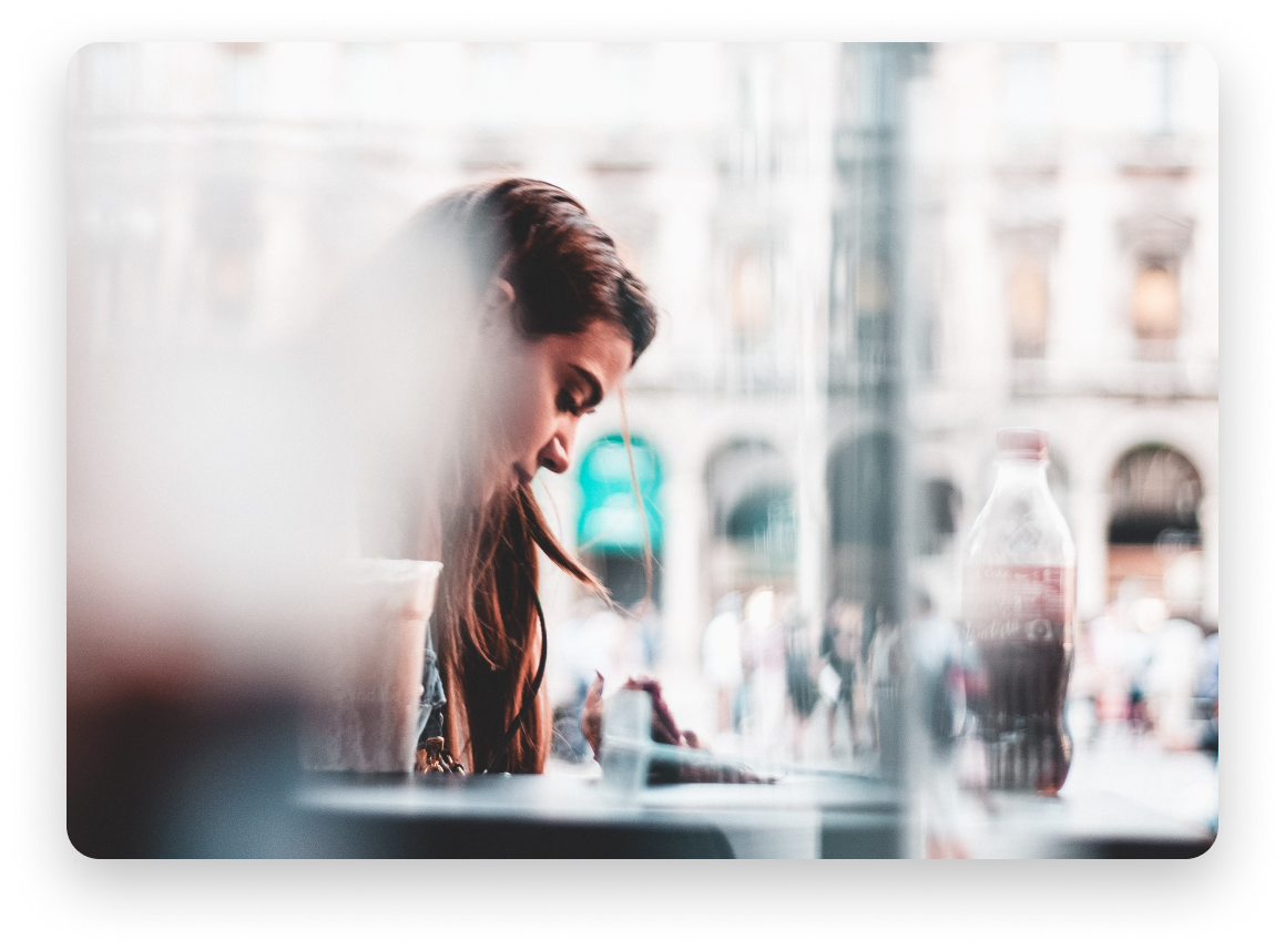 Woman looking down in a restaurant patio
