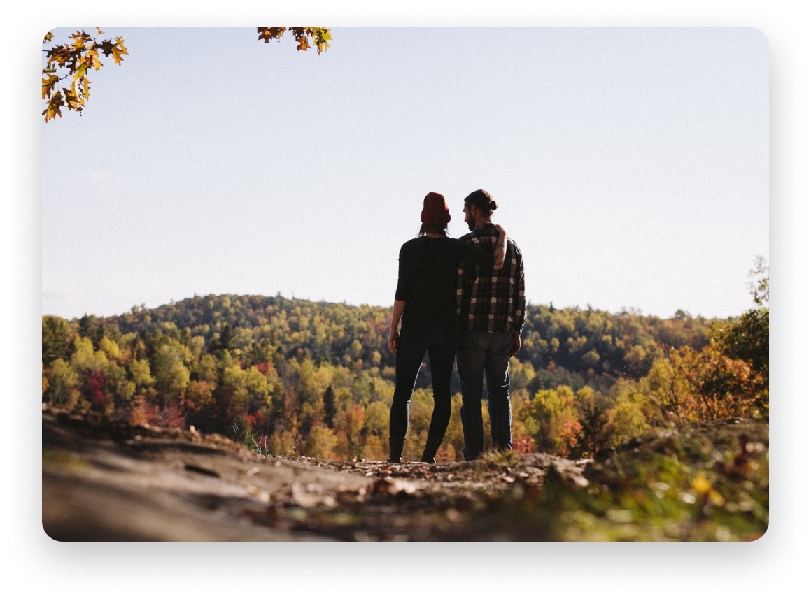 Couple looking out at nature in the fall