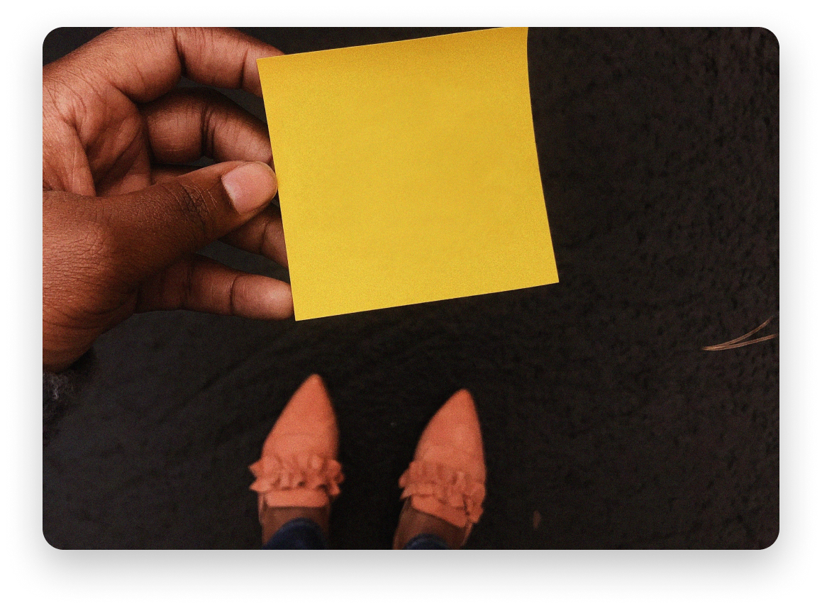 Woman holding blank sticky note