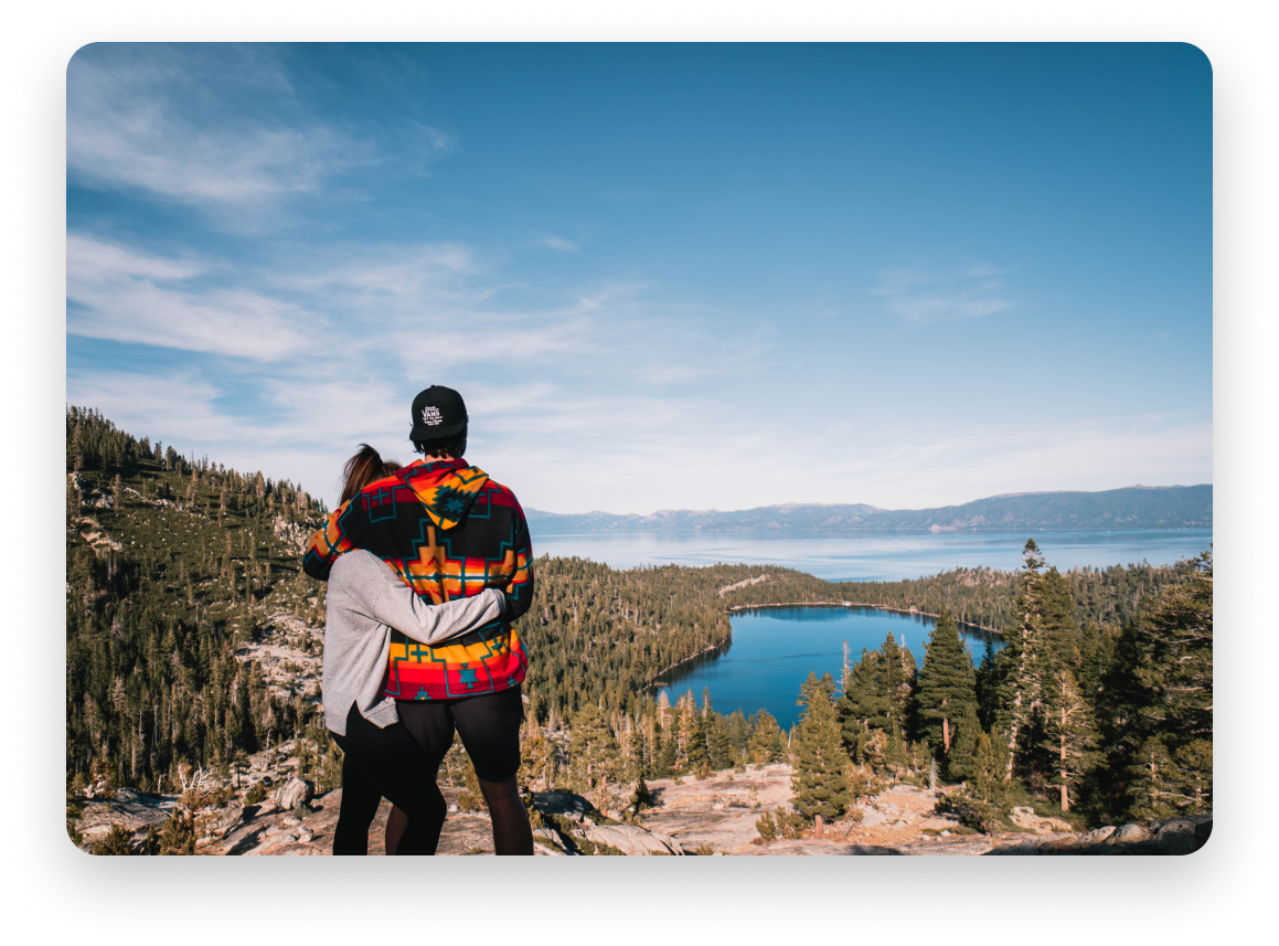 Couple looking out at first during hike