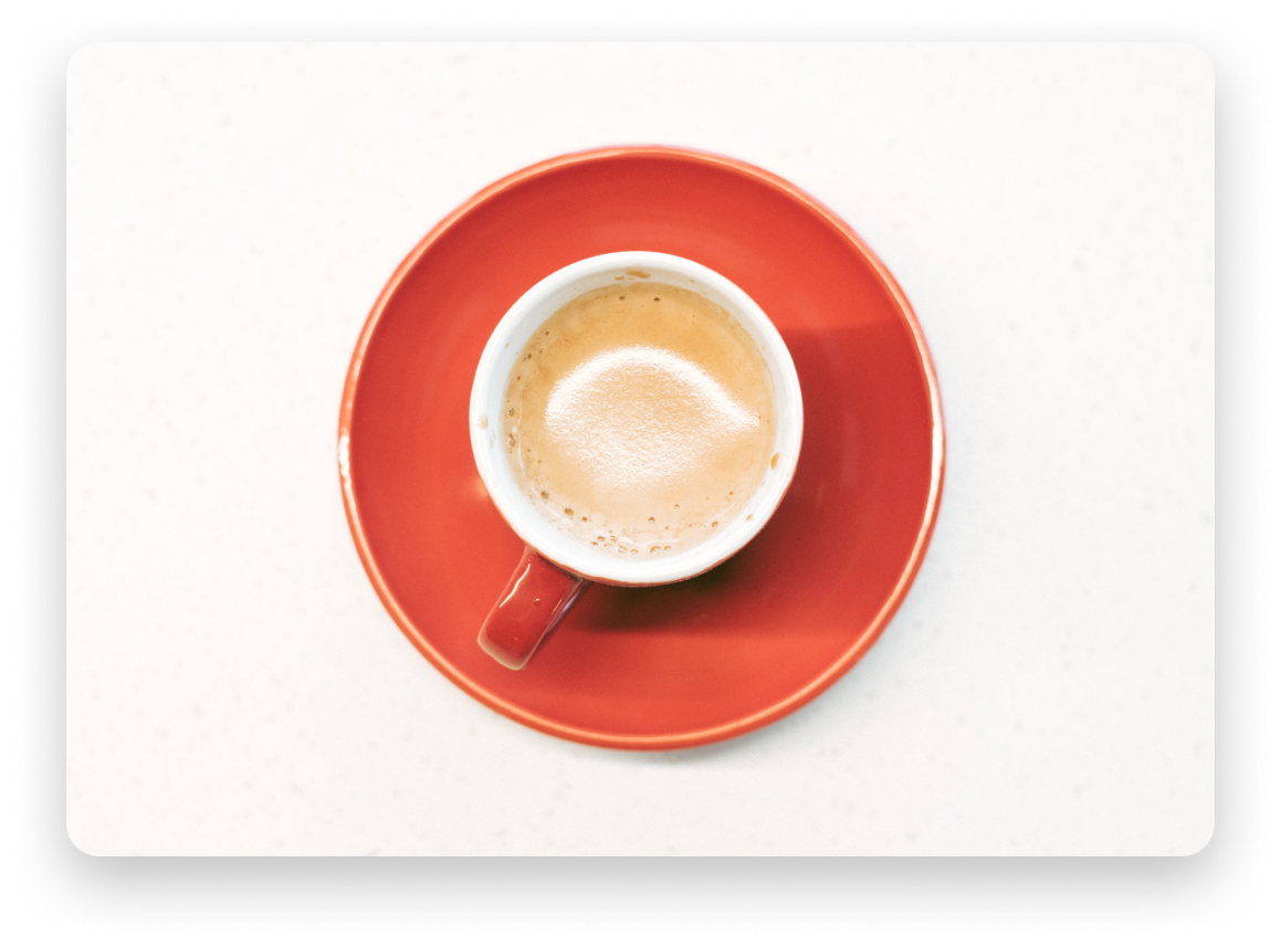 Latte on a red saucer cup with a white background
