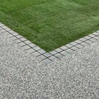 premium garden resin, framing the grass