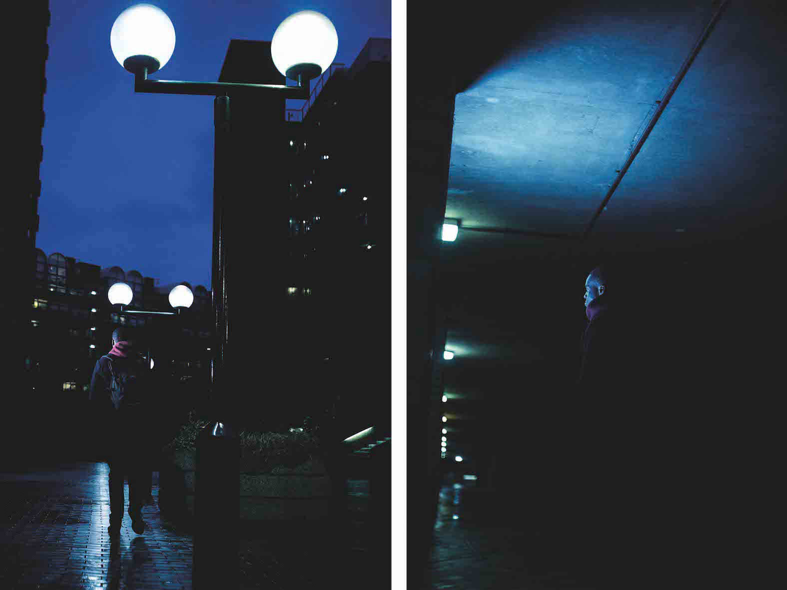 A silhouette of a man seen from the back, walking at night, barely lit, at the Barbican Centre, London, UK.