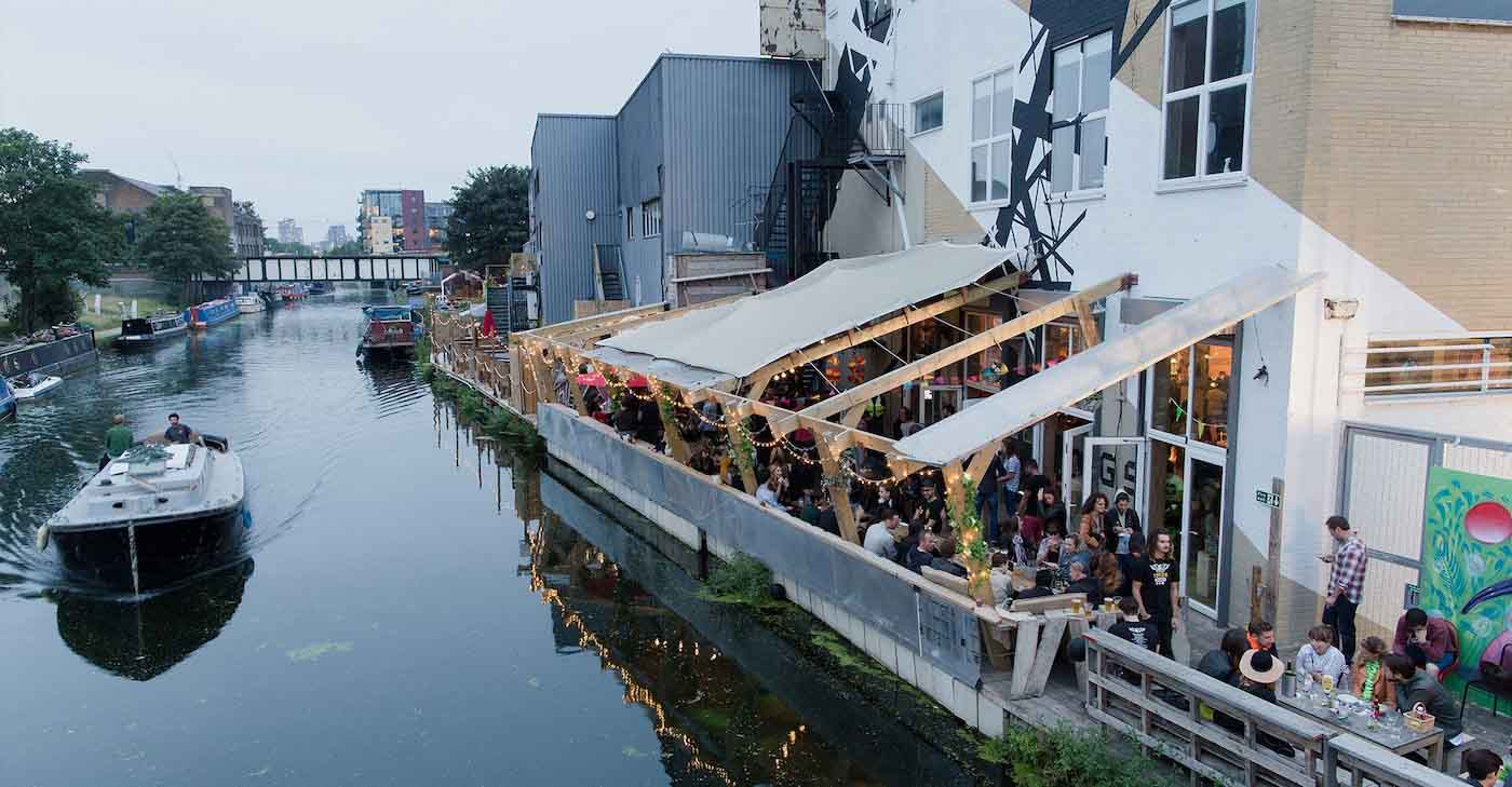 View from above of people on the terrace at Number 90 Bar and Kitchen, along the River Lea in Hackney Wick, East London