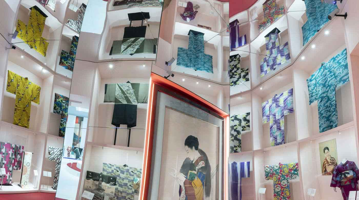 An exhibition in the Victoria and Albert Museum, London, of a kimono display, in a room filled with mirrors