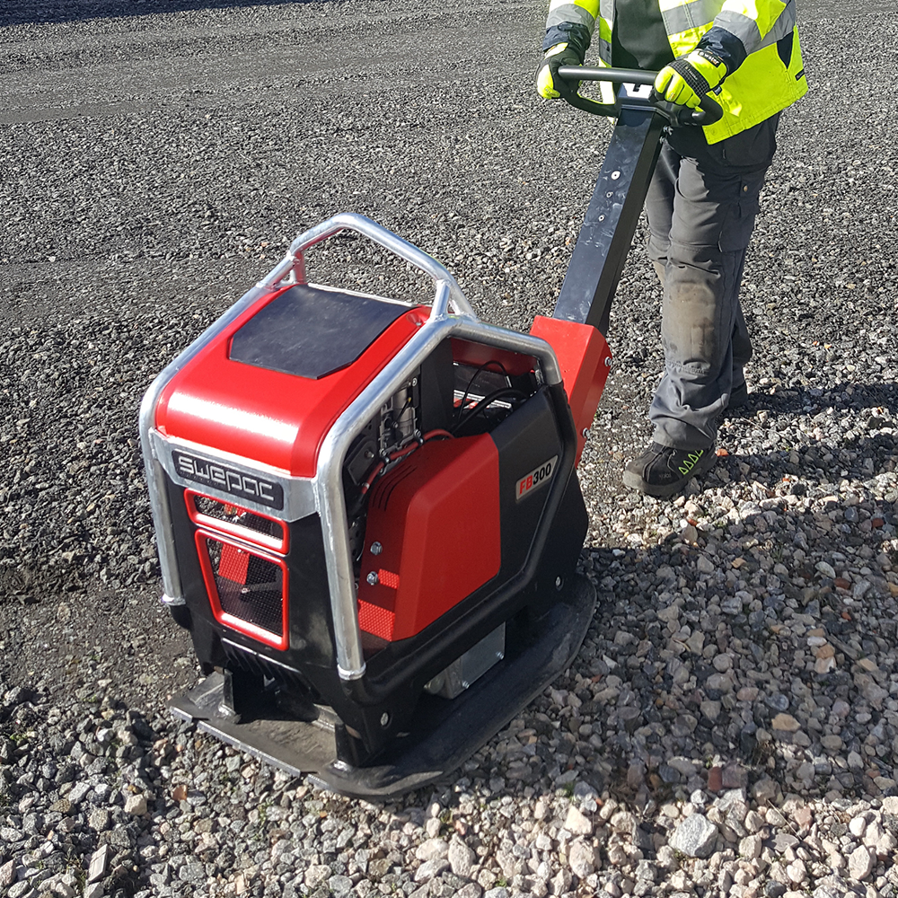 Construction worker with Swepac Soil Compactor