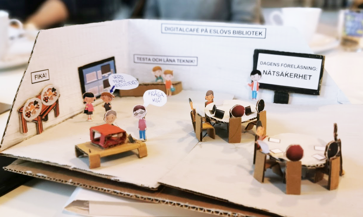 Miniature of people in a library made of carton