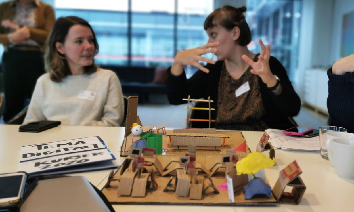 Two women workshopping and building prototypes in carton