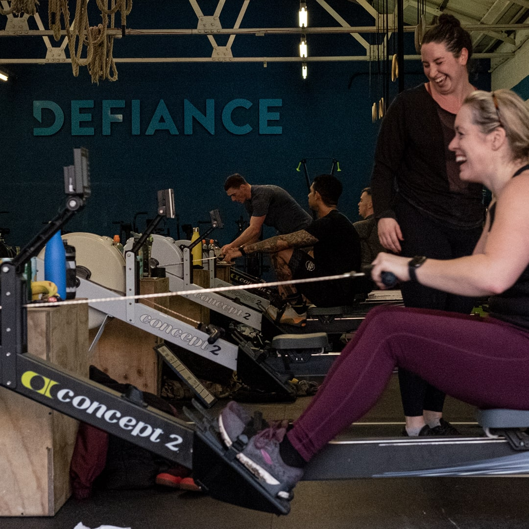 DefianceFit members during a rowing workout.