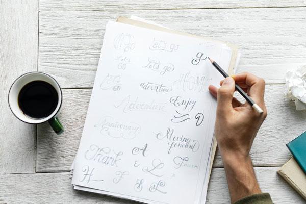 Sketching logos: pencil on paper