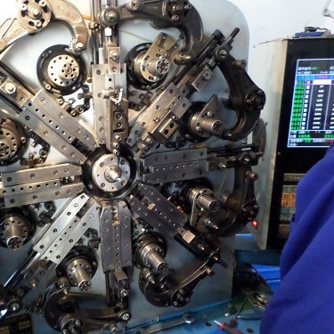 Complex machine that used to mass produce parts utilising metal wires.