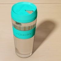 Double glass cup with turquoise lid.