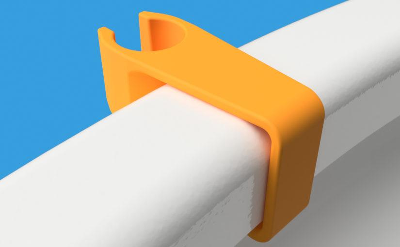 Plastic attachment for toilet sprayer.