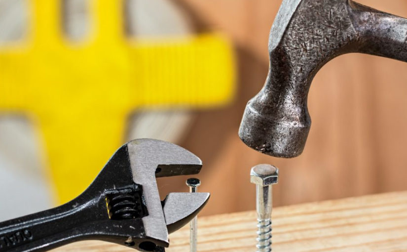 A hammer on a bolt and a wrench on a nail.