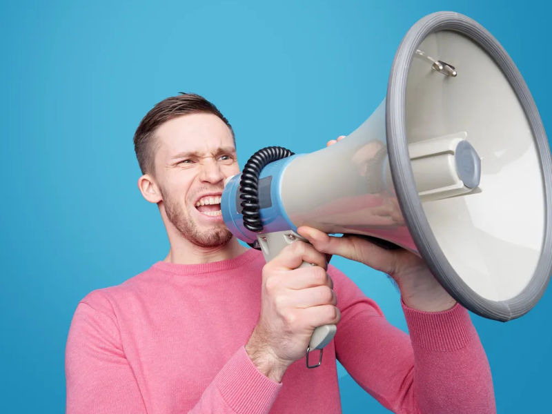 A guy shouting in a megaphone.