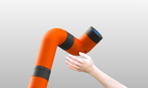 An image of M2 cobot arm with a human hand approaching