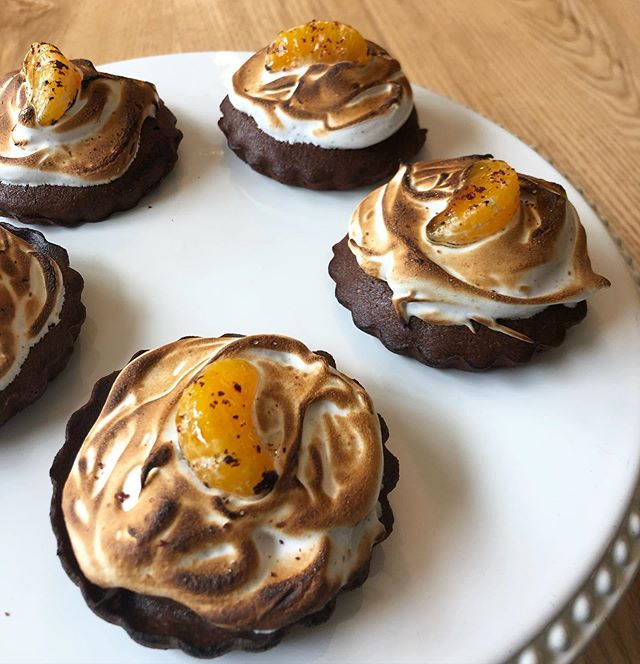 Chocolate Buckwheat Meringue Cakes (with a brûlée'd mandarin and a sprinkle of sumac) fresh out of the oven... on today's lunch menu.