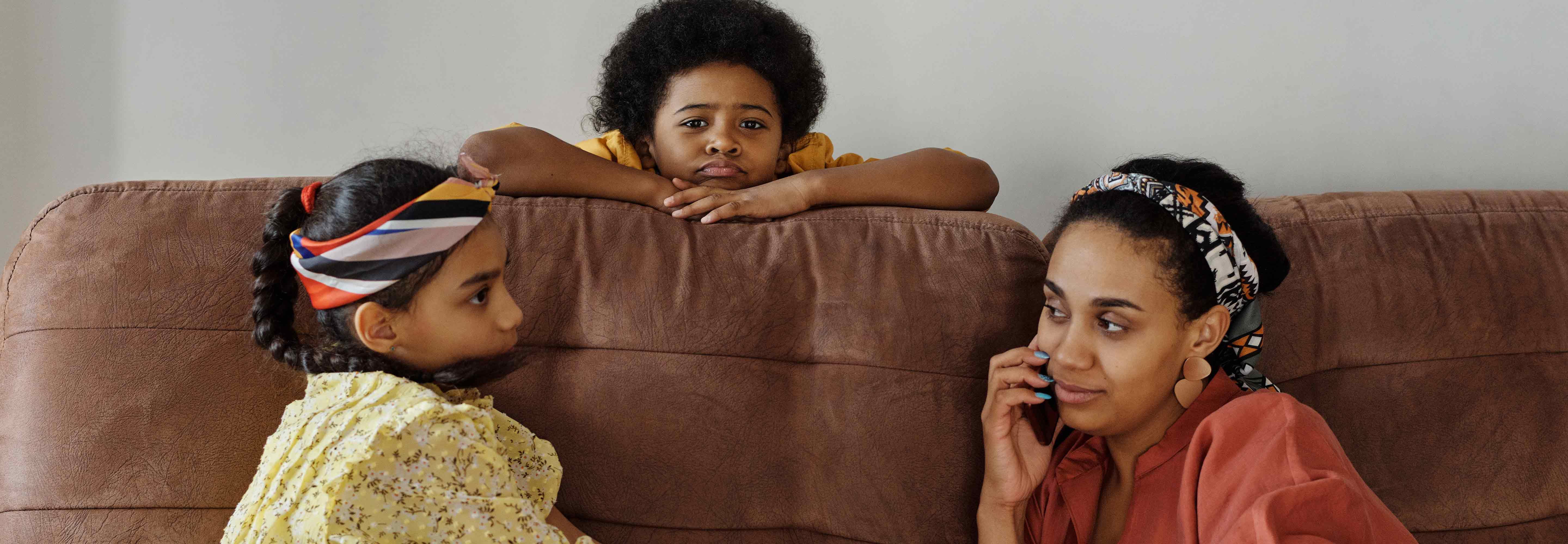 Mom and daughter sitting on a couch
