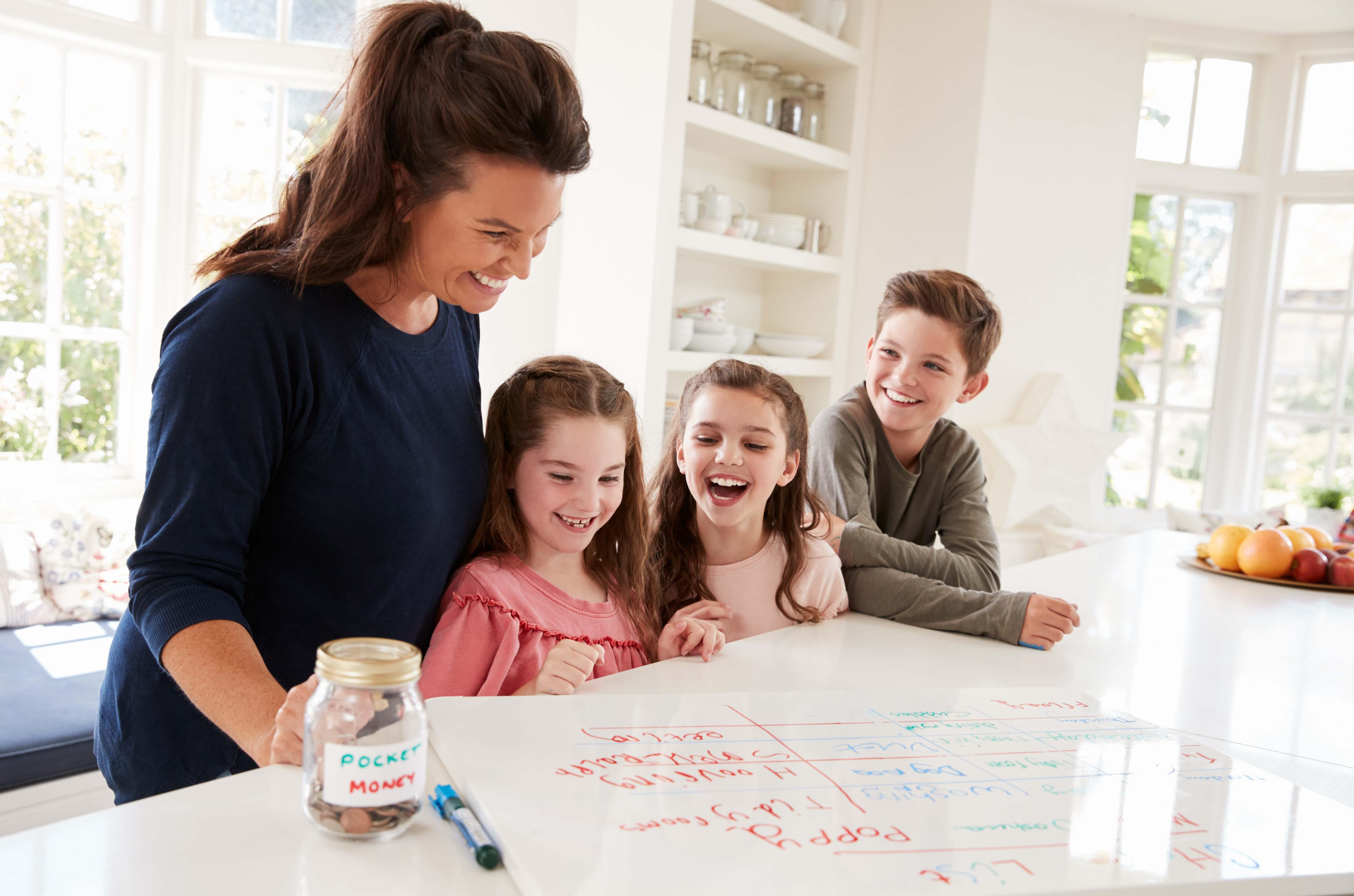 mother teaching kids finances