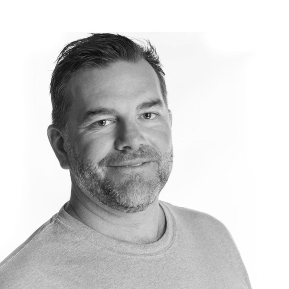 Headshot of Ryan Johnson, Partner & Chief Executive Officer  @ defyThemAll Agency