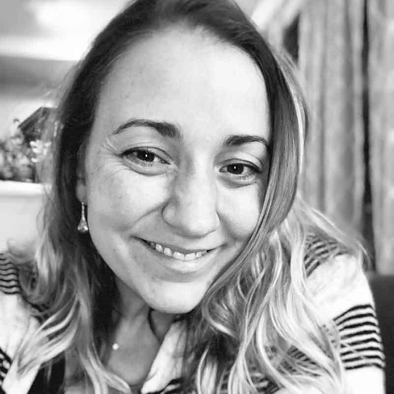 Headshot of Jen Hohn, Partner & Chief Creative Officer @ defyThemAll Agency