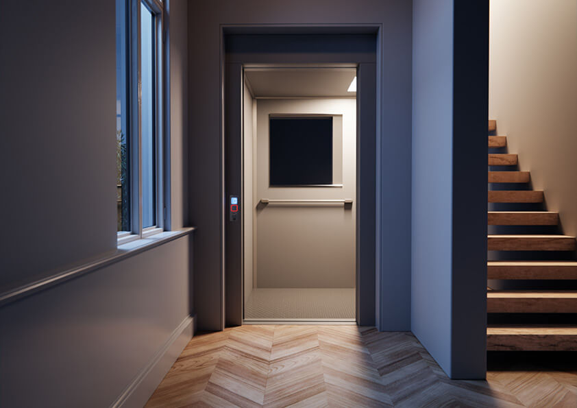 Home lift at night showing warm lighting by a wood staircase.